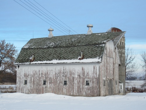 The barn in February. We have since torn the silo down.