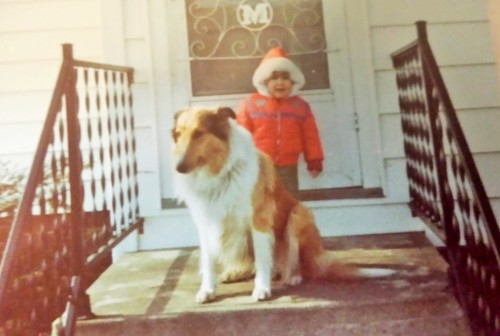 Me at age 2 standing in front of what is now my front door with my first dog, Tanya.